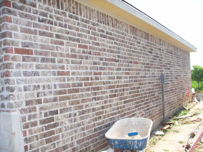 11-Gonzalezs-Residence-Side-Brick